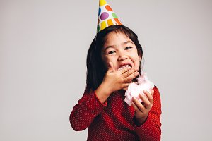 Close up of a kid enjoying candy