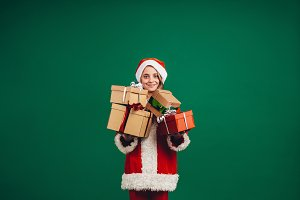 Smiling girl in santa claus dress