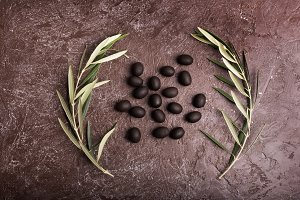 Olive branch on brown background