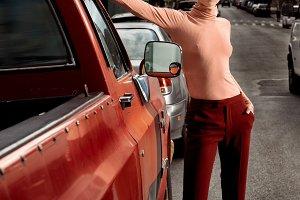 model wearing sexy red velvet pants