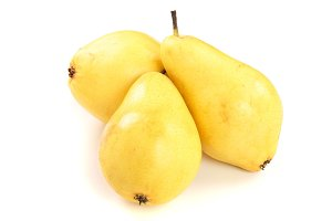 Three ripe yellow pear fruits