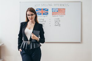 Female teacher in classroom English