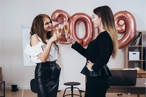 Two business women having party at