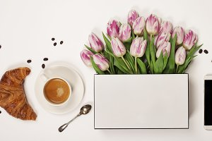 Top view of spring flowers, coffee,