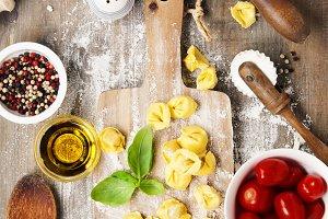 raw italian pasta tortellini on wood