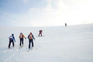 Skitouring group with mountain views