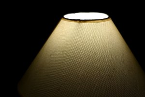 rustic lamp lit and black background