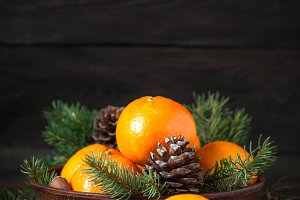 Tangerines, fir tree, pinecones and