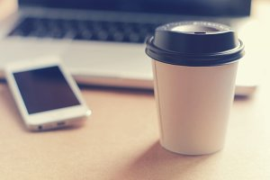 Paper coffee cup and workspace item