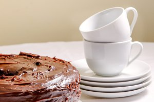 Chocolate cake and white dishes