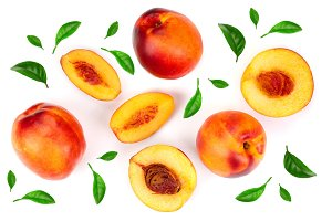 ripe nectarine with leaves isolated