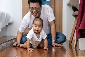 Asian baby boy crawl on the wooden f