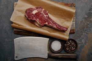 top view of raw rib eye steak on bak
