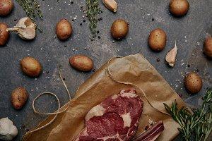 flat lay with raw meat steak on baki