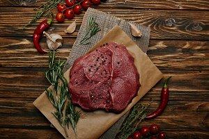 flat lay with fresh raw meat on baki