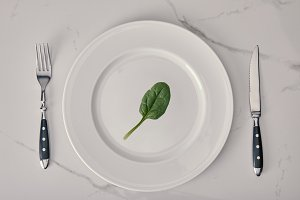 empty plate with fork and knife with