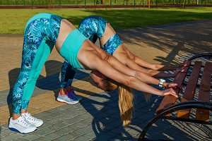 girls doing exercises on the sports