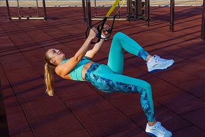 girl doing exercises on the sports f