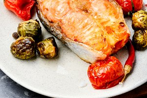 Baked salmon on plate