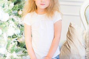 Cute girl and Christmas Tree