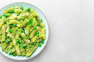 Tasty appetizing pasta with pesto on