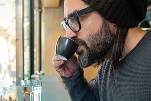 hipster guy having coffee