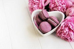 Pink peony flowers with macarons