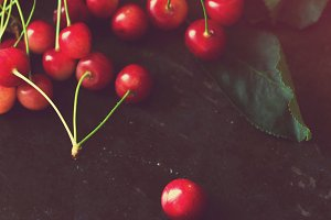 Cherries on dark background.