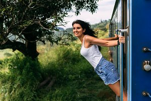 Girl riding a train
