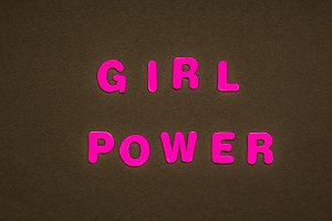 GIRL POWER writing on black paper ba