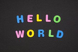 Hello world writing on black paper b