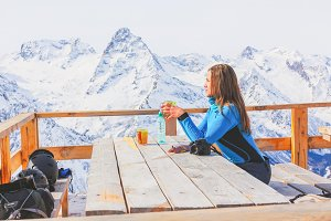 Girl in a cafe on the mountains.