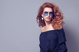 Sensual Redhead woman in Studio. Tre