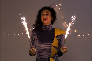 Young happy woman with sparklers