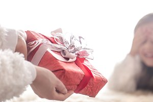 Christmas concept, Mom gives a gift
