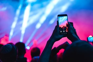 spectators at a concert phone close