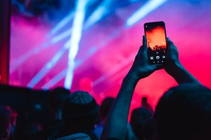 spectators at a concert phone close
