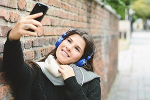Portrait of young woman taking selfi