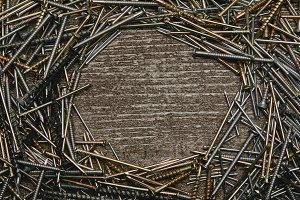 Top view of nails arranged on wooden