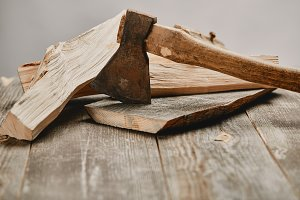 Close up view of axe and wood logs o