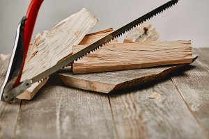 Close up view of hacksaw and wood lo