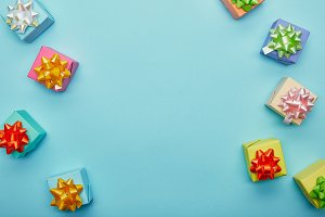 Top view of colorful gifts on blue