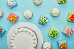 Top view of delicious cake, cupcakes