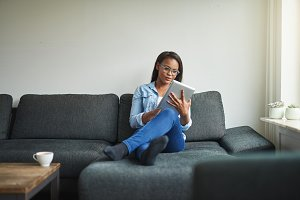 Young African woman sitting at home