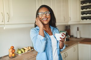 Laughing African woman drinking coff