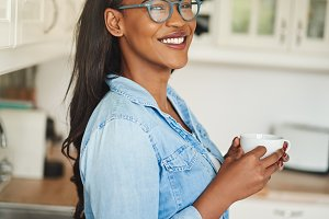 Smiling young African woman enjoying