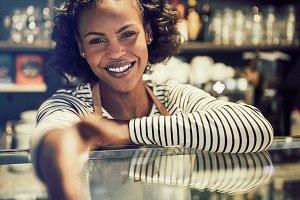 Smiling African entrepreneur shaking