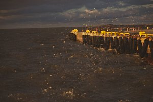 Pier in the sea in a storm