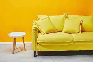 Yellow sofa and pillows
