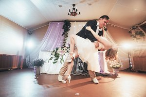 bride and groom first dancing on bac